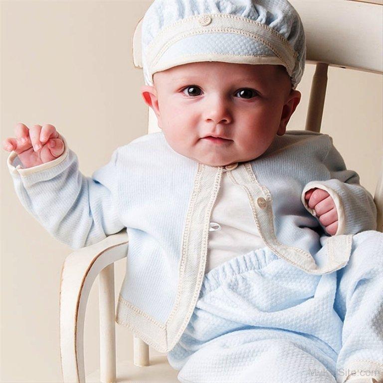 Cute Baby Boy In White Dress